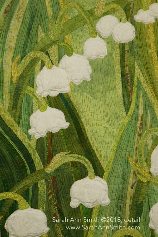 Sarah Ann Smith's Lilies of the Valley art quilt features small white flowers against a field of green
